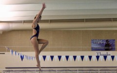 Emily Clark practices a dive by herself during a practice earlier this week.