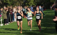Freshman varsity runners, Gretchen Highberger and Lydia Sommer, battle through the last 200 meters of the district meet's course at Crow Creek on October 24th.