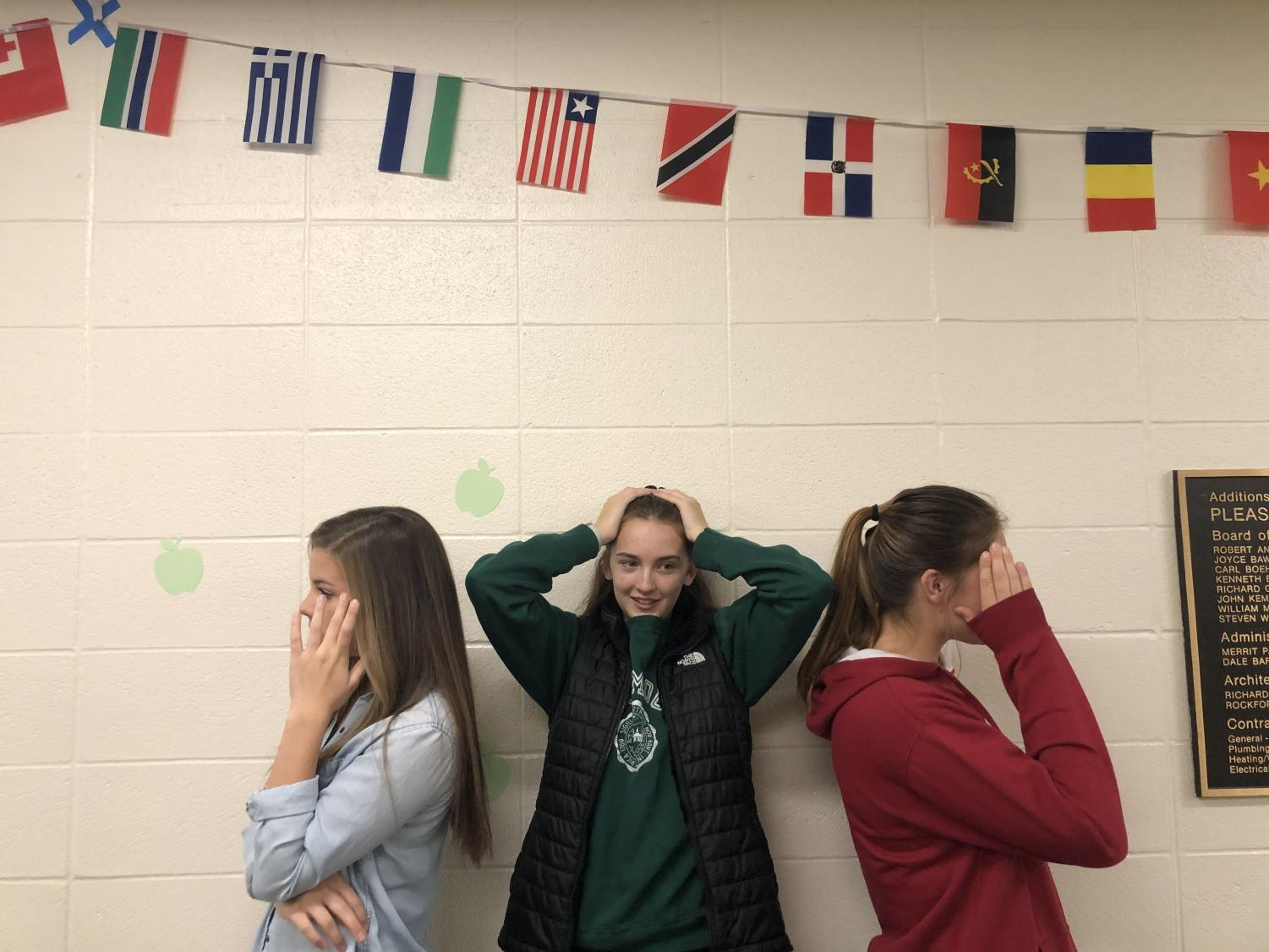 Grace Halupnik (left), Maddy Licea (center) and Taylor English (right) show frustration in school due to the arguing between different political views.