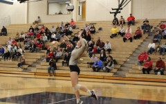 Emily Wood leaps up to serve the ball against the Knights.
