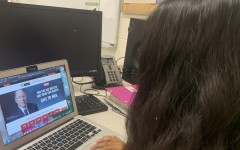 Senior Sakshi Lawande looking at the NRA donor website featuring CEO LaPierre.
