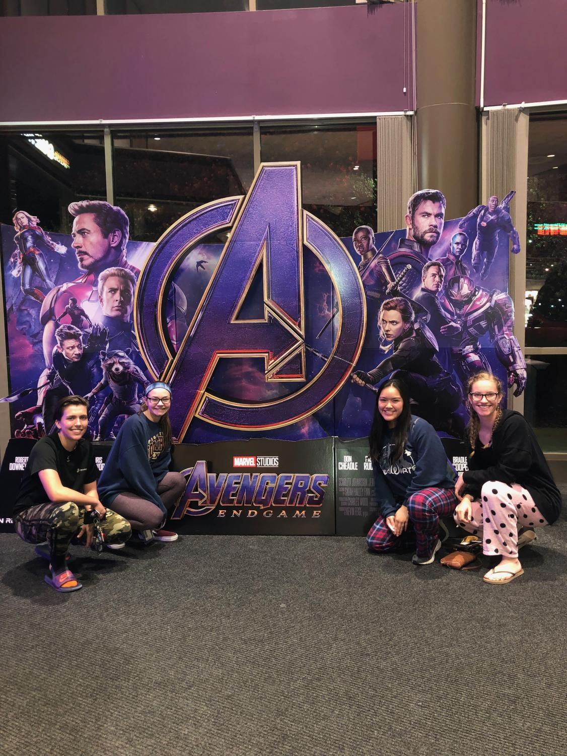 Female students Maria Vaaler (left), Ada Duncan (left-center), Nikki Chang (right-center) and Katie Bullock (right) pose in front of an Avengers: Endgame cutout prior to watching the movie.