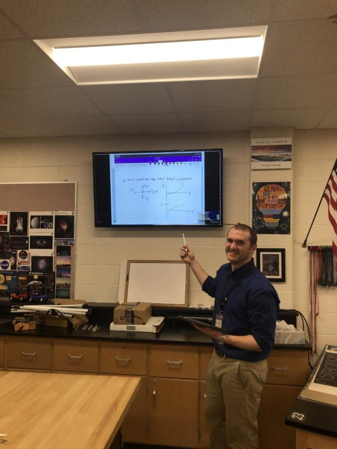 Ian Spangenberg teaches a lesson to his AP Physics II students.
