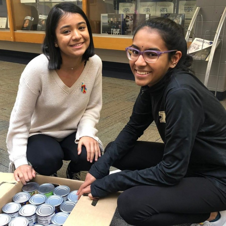 Spartan Assembly executives Muskan Basnet and Ramya Subramaniam counting cans to donate to the River Bend Food Bank.