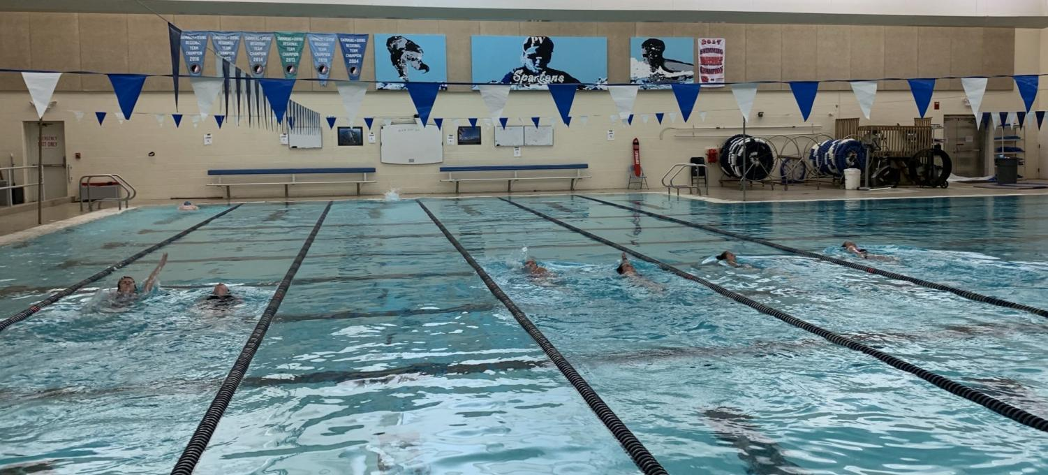 Softball pitchers and catchers complete a swim workout during the winter off-season to improve physical and mental strength.