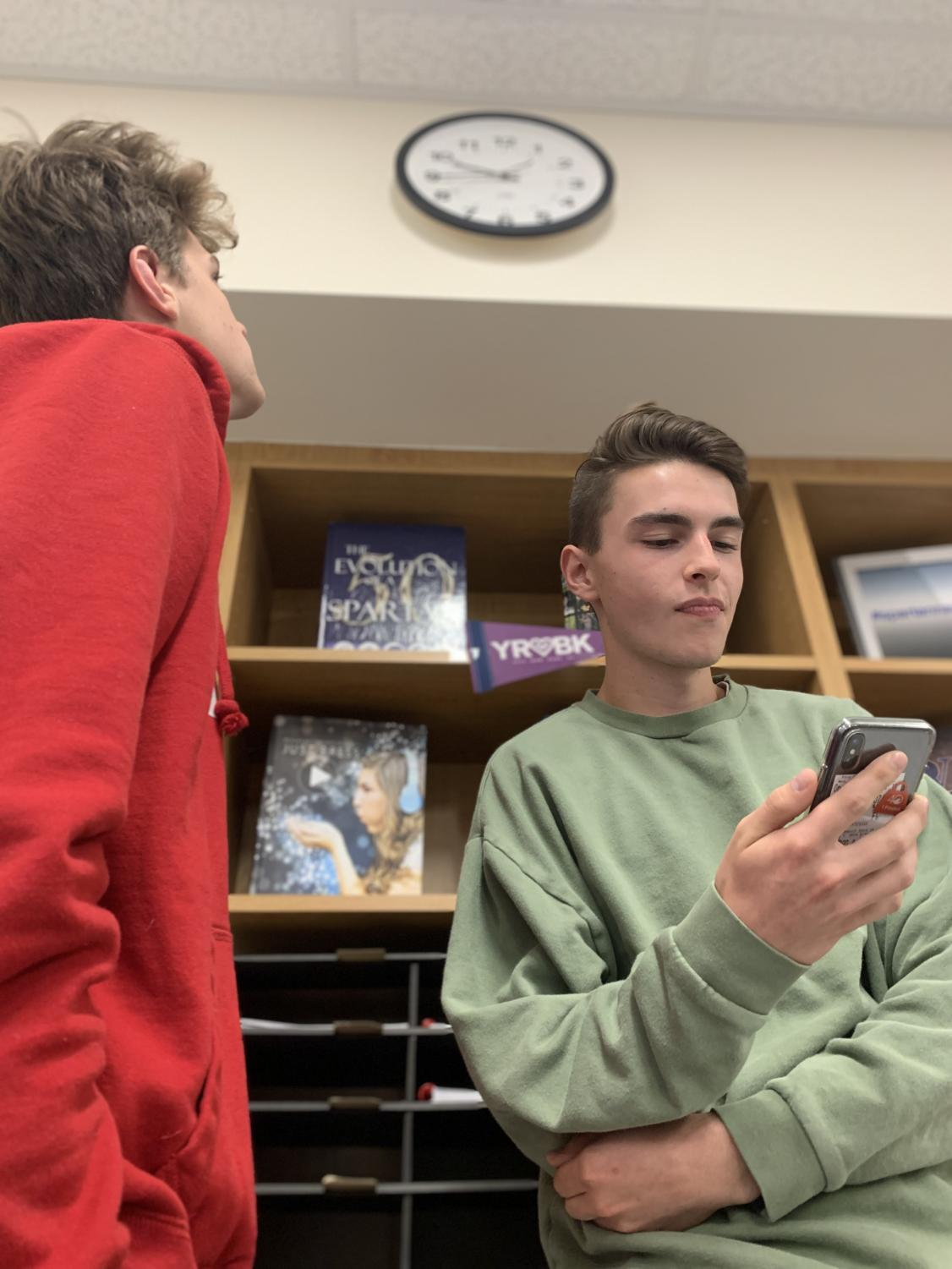 Seniors Jackson Schou (right) and Jack Donahue (left) look at the time, waiting for class to end without the bell.