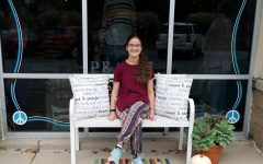 Senior Miranda Miller sits in front of Bettendorfs Peaceful Style Boutique.