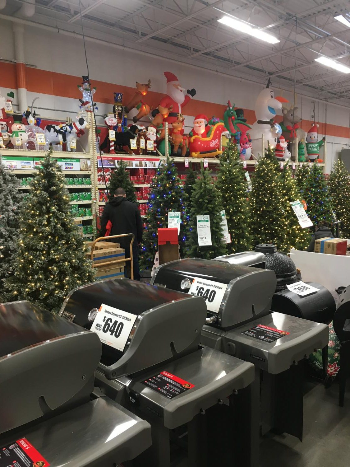 Shoppers look at the Black Friday deals and Christmas decorations at the Middle Road Home Depot one week before Thanksgiving.