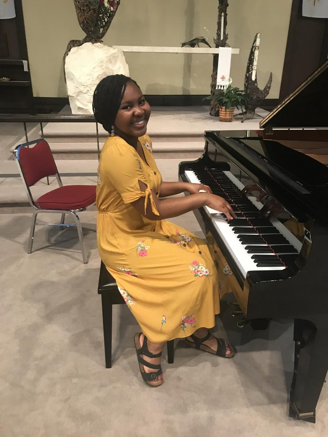 Amber Matthews demonstrates one of her greatest passions of playing the piano.