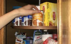Student reaches into the cupboard to to get an important ingredient for fan favorite number 5.