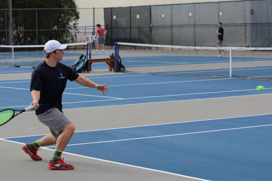 PV+graduate+Justin+Sehlin+plays+in+a+tennis+meet+at+Pleasant+Valley+High+School.