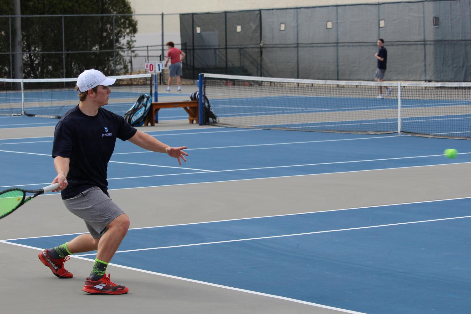 PV graduate Justin Sehlin plays in a tennis meet at Pleasant Valley High School.