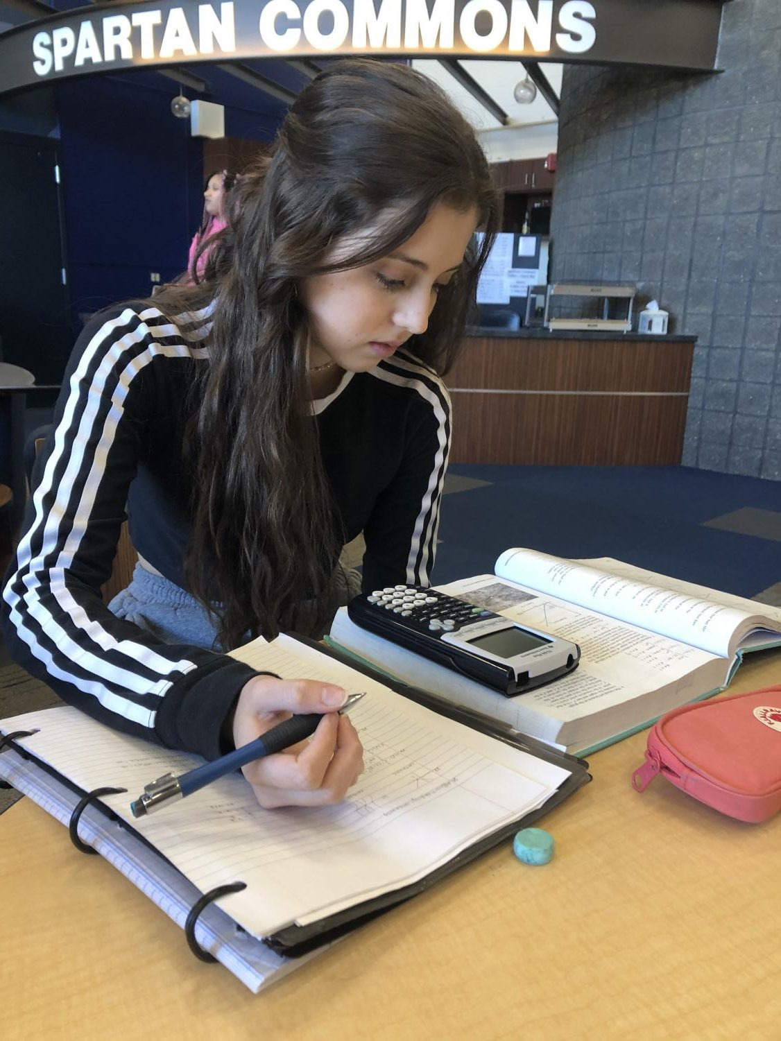 Senior Marali Sanchez works on homework during study hall in a U.S. educational environment.