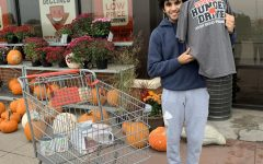 Junior Spartan Assembly member Sid Sharma takes a shift at the Bettendorf HyVee on Oct. 30 to collect donations for the Student Hunger Drive.