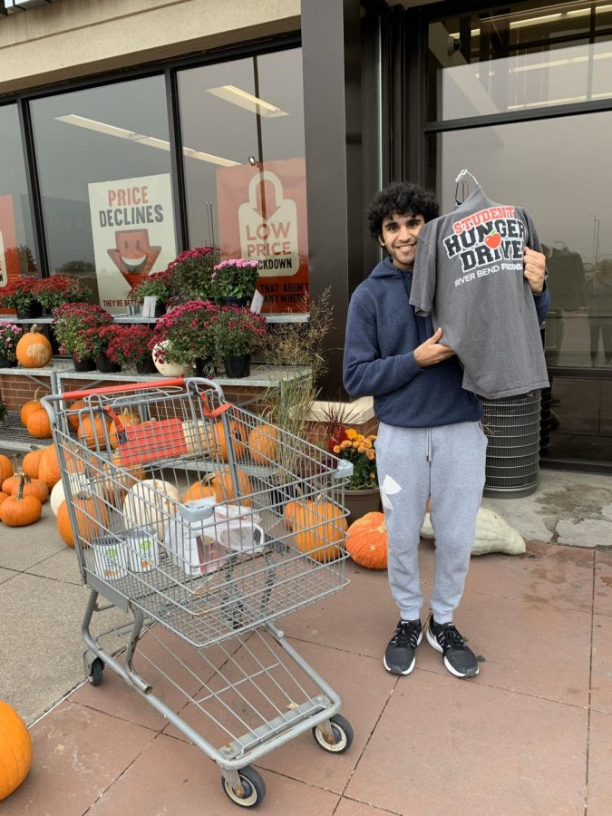 Junior+Spartan+Assembly+member+Sid+Sharma+takes+a+shift+at+the+Bettendorf+HyVee+on+Oct.+30+to+collect+donations+for+the+Student+Hunger+Drive.