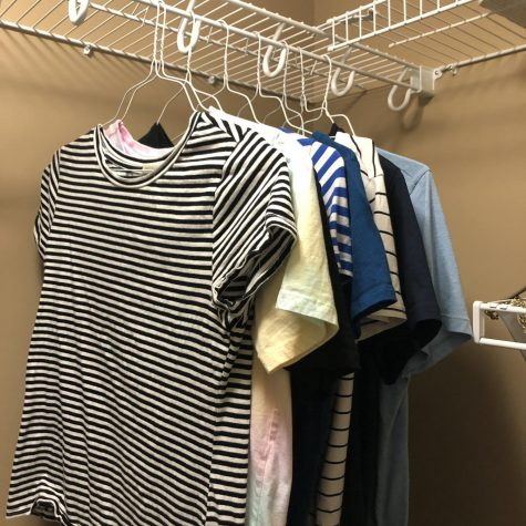 A rack of T-shirts produced by the fast fashion industry.