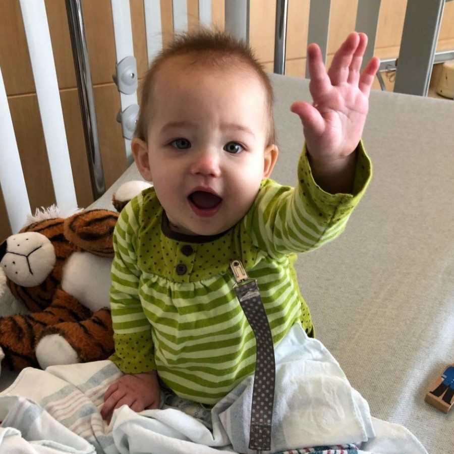 Olivia Waytenek plays in her crib at the University of Iowa Stead Family Children's Hospital between treatments. Olivia, daughter of English teacher Tracy Lux, was diagnosed with a rare form of leukemia in October.