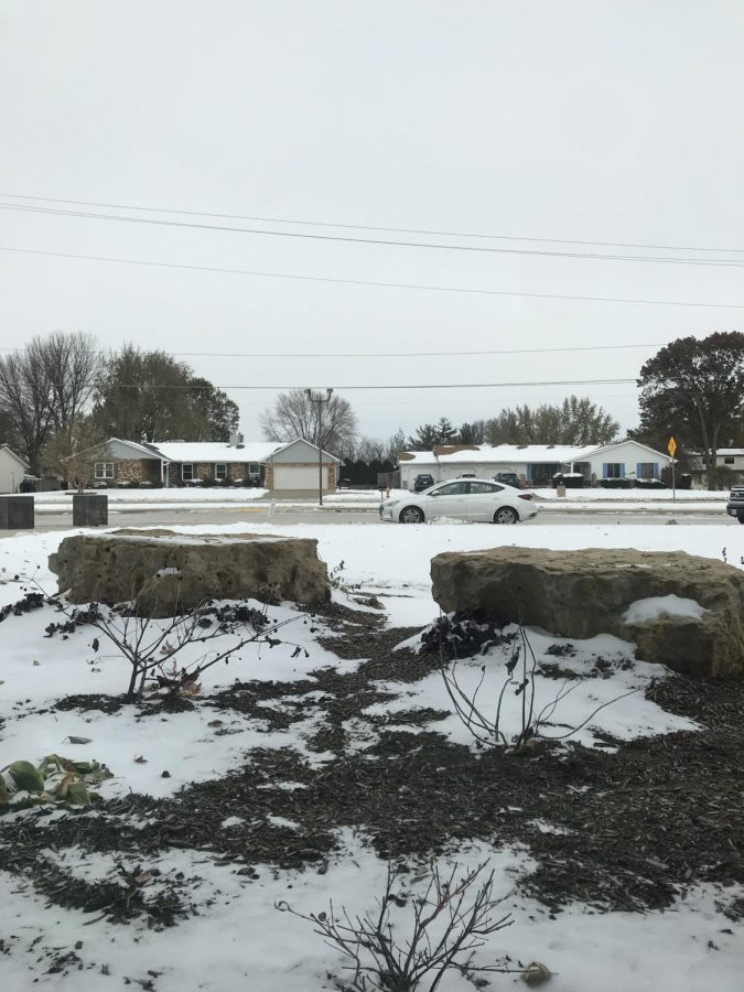 PV's drop off zone in front of the school was one of the several sites that were covered in both ice and snow last Monday.
