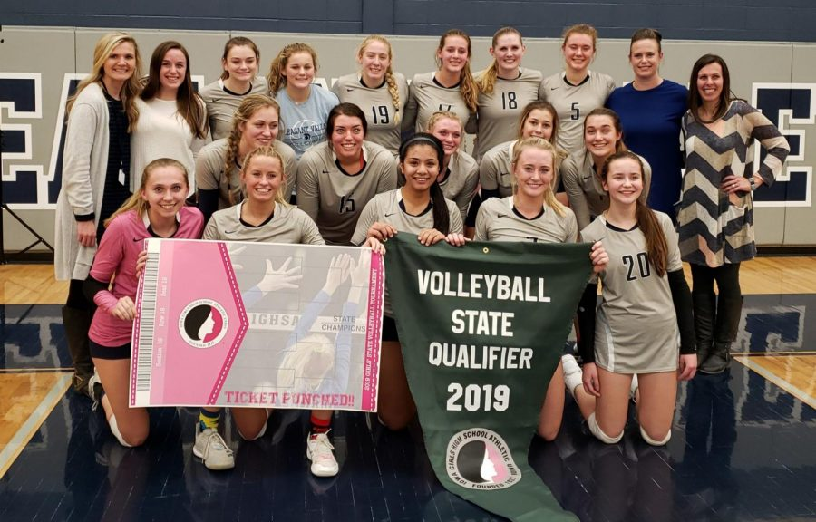 The+girls+volleyball+team+holds+their+banner+after+qualifying+for+state+for+the+first+time+in+six+years%2C+on+November+4%2C+2019.+