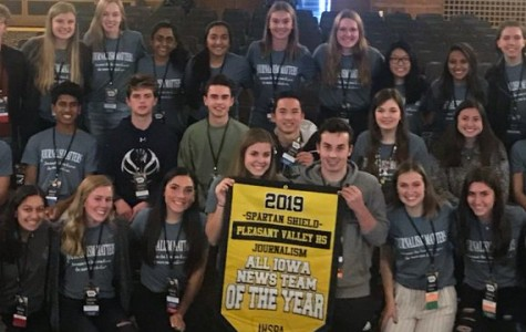 Shield and Valenian staff smile with their Iowa News Team of the Year banner at the Fall IHSPA conference on Oct. 24, 2019.