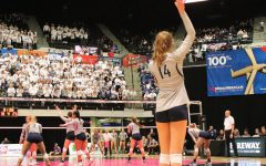 Freshman Chloe Cline serves the ball at the 5A State Volleyball Semi-Final.