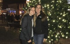 Junior Raegan Stein enjoys the holiday season with her mom at Christmas in the Village.