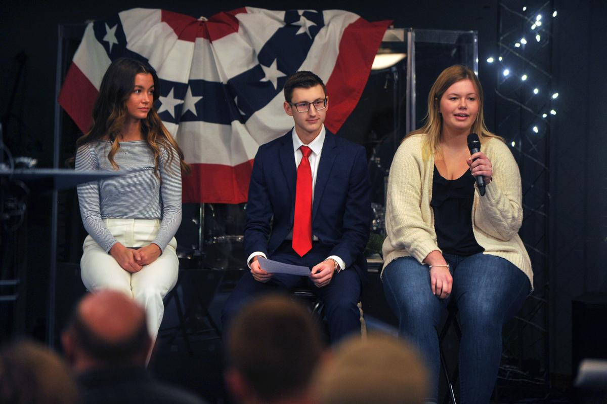Republican Teenage Campus Leaders, Olivia Schilling (left), Ben Crawford (middle) and Grace Thalacker (right) voice their opinions at the immigration forum in the Pleasant View Baptist Church on Monday.