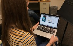 Senior Katie Gropel looks at a movie review for