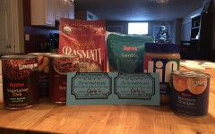 "Various food items that could be donated to worthy causes such as the Student Hunger Drive with a ""homework coupon"" used as a reward for this service."