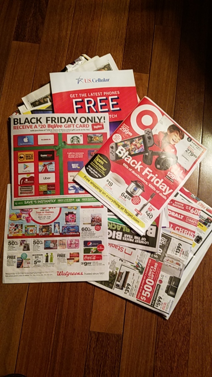 A pile of Black Friday ads collected by a student showcase the many deals that stores are offering for the holiday.