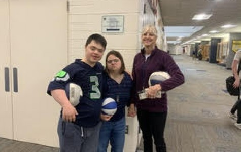 Meadows with two of her students. Freshman Christian Mali and Junior Rachel Wanke both gave a
