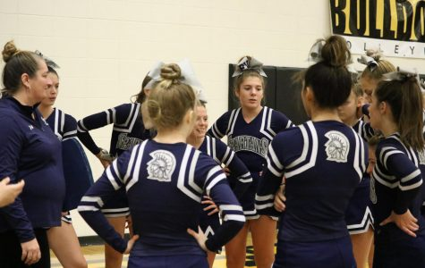 PV cheerleaders prepare for their local showcase at Bettendorf High School in late November.