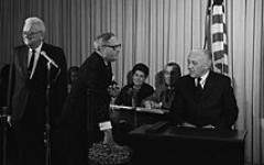 Representative Alexander Prime drawing the first number for the draft for the Vietnam War in 1969.
