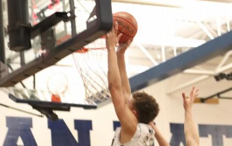 Junior CJ Ragins attempts a dunk.