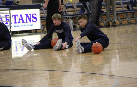 Juniors Jacob Townsend and CJ Ragins warm up before their game against Davenport West.