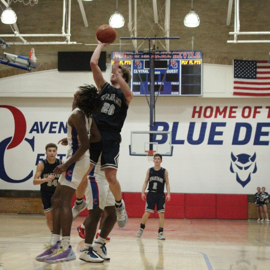 Junior Jacob Townsend jumps to hit the floater over a defender.