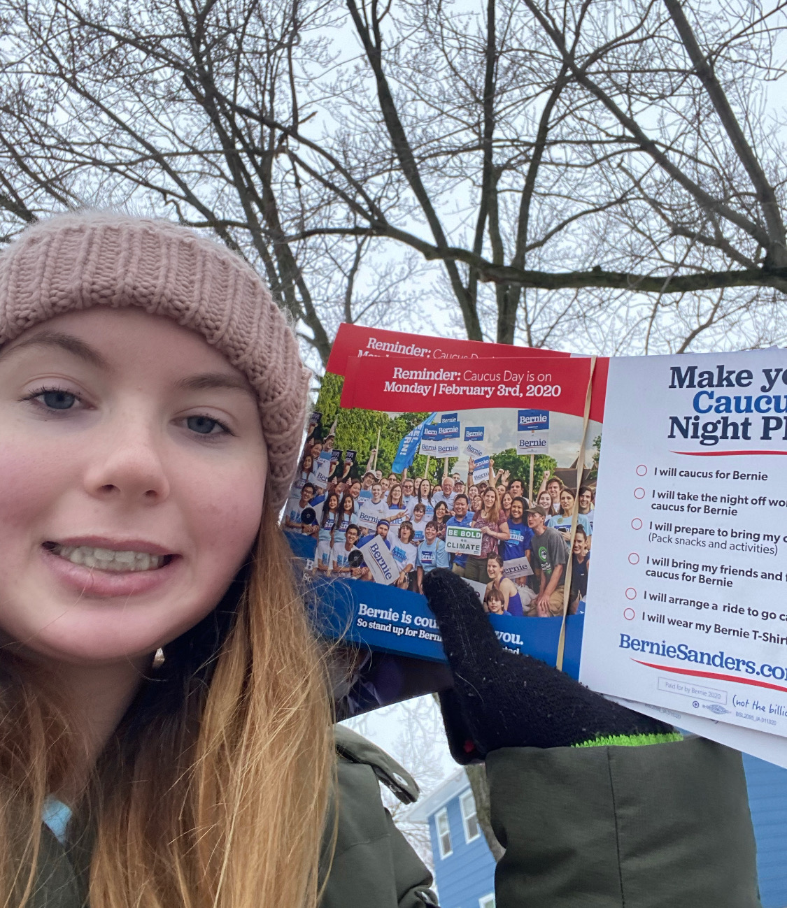 Amy Oberhart attempts to rally potential caucus voters in support of Bernie Sanders by travelling through local neighborhoods.