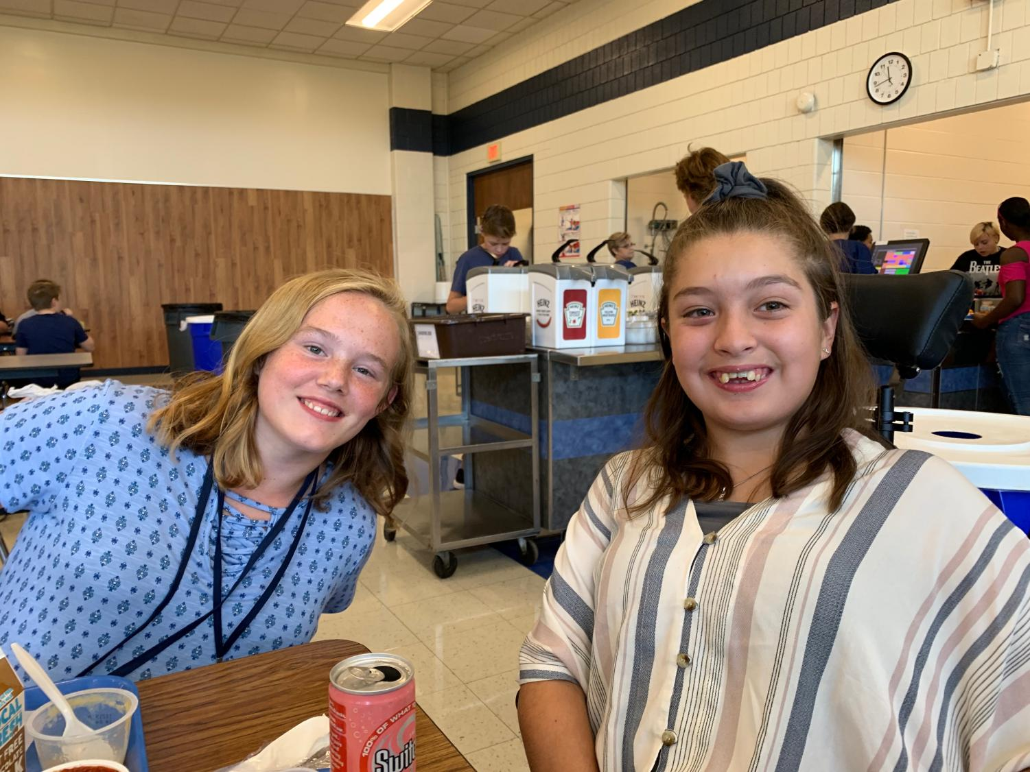 Jazzie Zupancic (left) and Madi Ramirez (right), the newest members of the PVJH Swim Team, enjoy lunch together at the junior high.