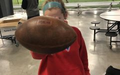 Junior Isabel Russmann holds a football to show her support of Katie Sowers.