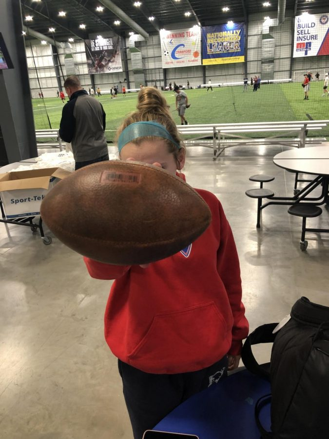 Junior+Isabel+Russmann+holds+a+football+to+show+her+support+of+Katie+Sowers.%0A%0A