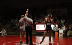 Eli Loyd gets his hand raised after beating North Scott's Nate Link at their dual meet in The Pit on Jan. 30, 2020.