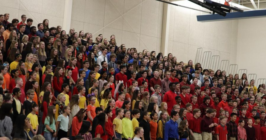 Pleasant Valley students dance and sing along to classic Disney songs at the annual District Choral Festival.