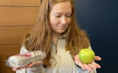 Senior Kelsey Murphy, deciding whether she wants to take the healthier or the less healthier path when choosing her snack in the PVHS Commons during study hall.