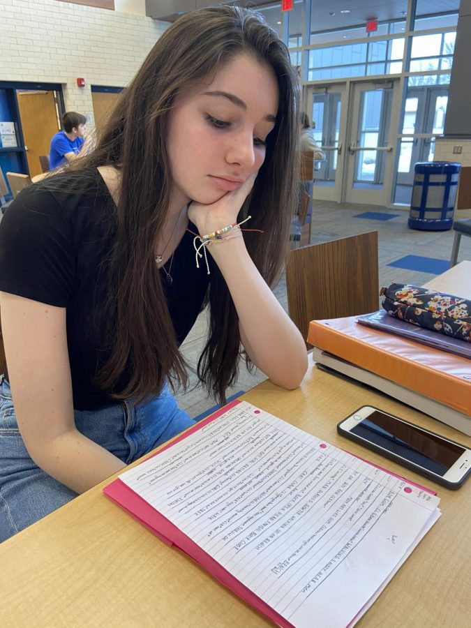 Junior Reese Thompson, fatigued from the inconsistent weather, struggles to have the energy to do her homework during study hall at PVHS.