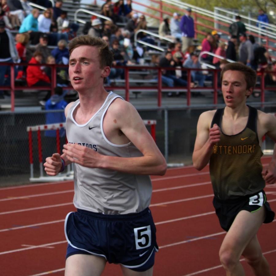 Senior Kent Nichols running at the North Scott track meet.