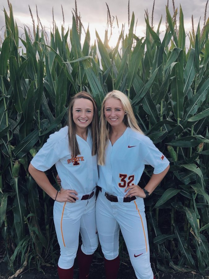 Carli (left) and Ellie (right) Spelhaug pose for a picture in their Iowa State Softball jerseys.