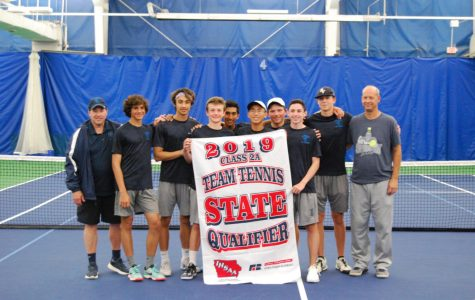 Pleasant Valley boys tennis team being awarded their state qualifier flag for their 2019 season.