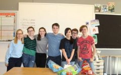 The PV art club poses with some of their work at a chips and salsa party last week.