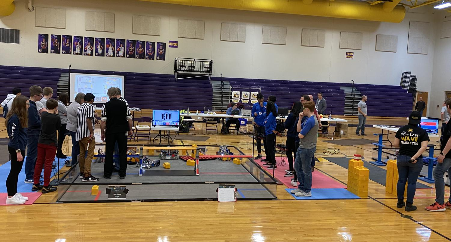 Robotics teams Flourish, Bots and Winter Soldiers competing against each other for a match at the League Championship at Central Dewitt High School.