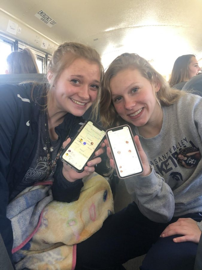 Juniors Jessi Meyer and Isabel Russman show their tracking apps.